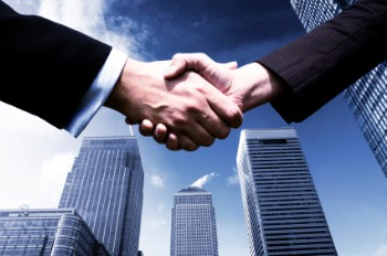 Business deal handshake in the city. CSI Janitorial Quotes Page